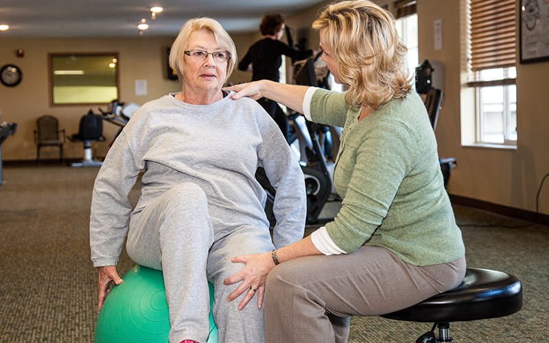 Progressive Care Therapy working on fitness ball
