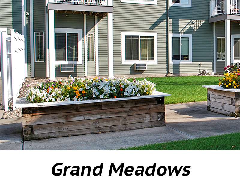 Grand Meadows Exterior with flower beds