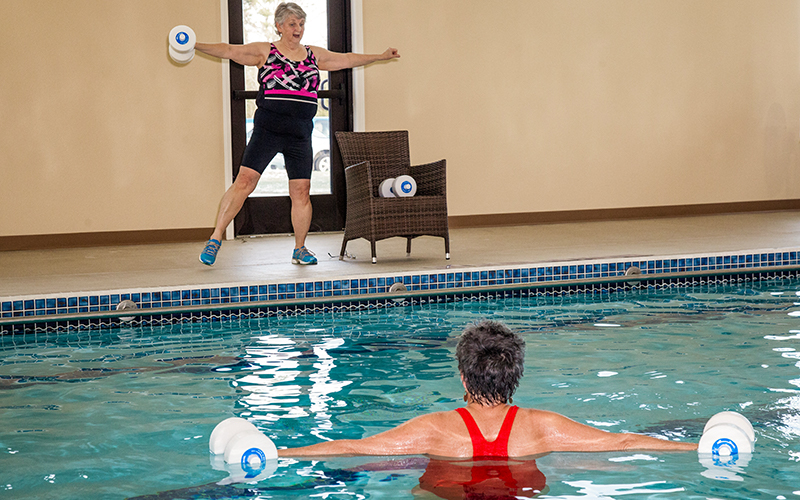 Two ladies working on warm water pool exercises